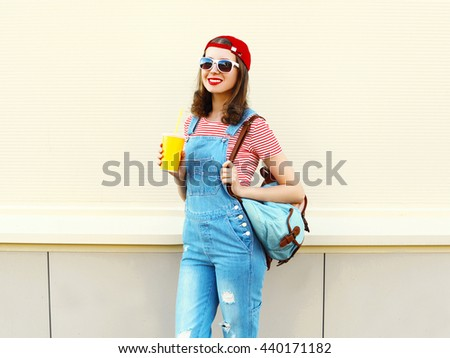 Fashion pretty cool smiling woman with cup over white background