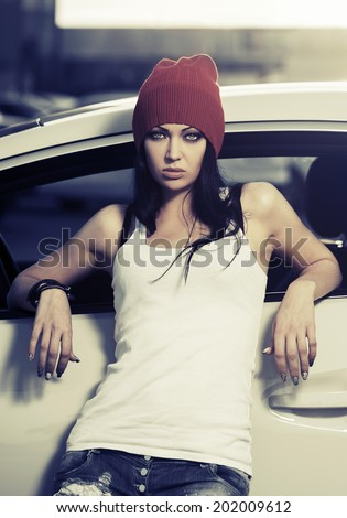 Fashion punk woman standing at the car - stock photo