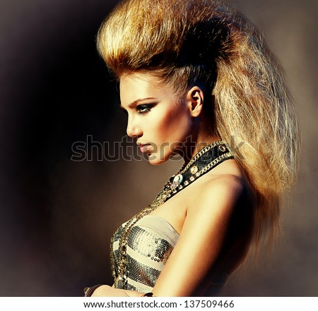 Fashion Rocker Style Model Girl Portrait. Hairstyle. Rocker or Punk Woman Makeup, Hairdo and Accessories  - stock photo