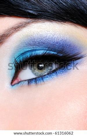 Fashion saturated make-up with long false eyelashes - stock photo