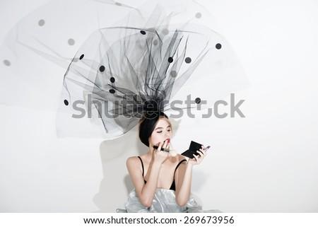 Fashion sensual beautiful woman under the black veil - stock photo
