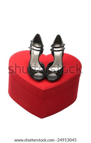 Fashion series: woman's black shoes on the heart box - stock photo