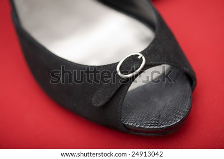 Fashion series: woman's black shoes  over red - stock photo