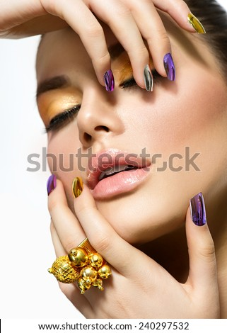 Fashion sexy Beauty model. Manicure and Make-up. Nail Art. Beautiful Woman With Colorful Nails and Luxury Makeup. Beautiful Girl Face and Hands  - stock photo
