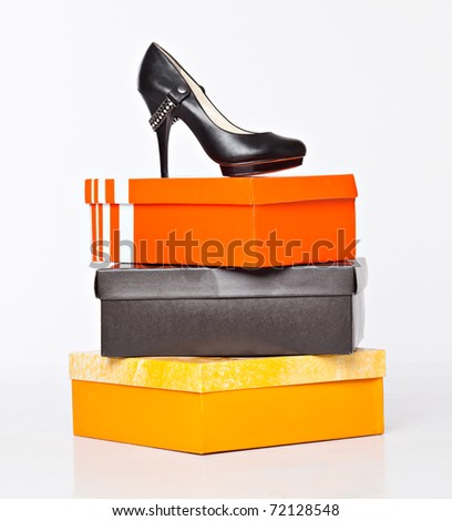 fashion shoes on the boxes. isolated on a white background - stock photo
