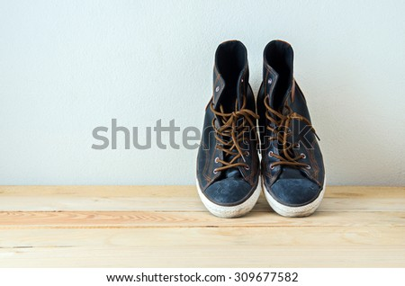 fashion shoes on wooden table