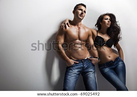 Fashion shoot of a sexy couple - stock photo