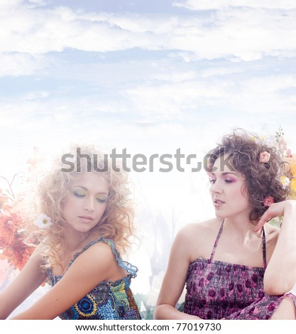 Fashion shoot of young beautiful nymphs in the spring forest - stock photo