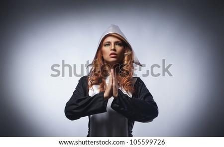 Fashion shoot of young sexy nun - stock photo