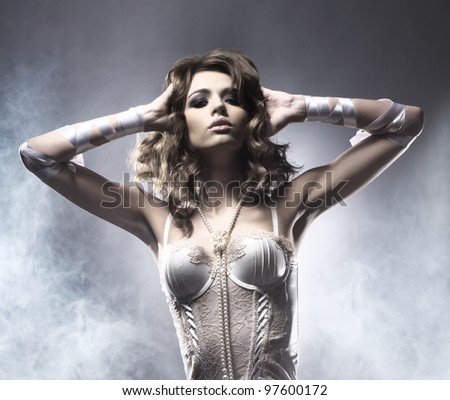 Fashion shoot of young sexy woman in modern lingerie - stock photo