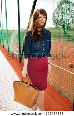 Fashion shoot on playground. - stock photo