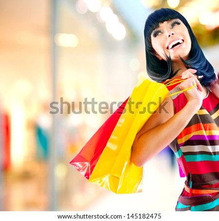 Fashion Shopping Girl Portrait. Beauty Woman with Shopping Bags in Shopping Mall. Shopper. Sales. Shopping Center
