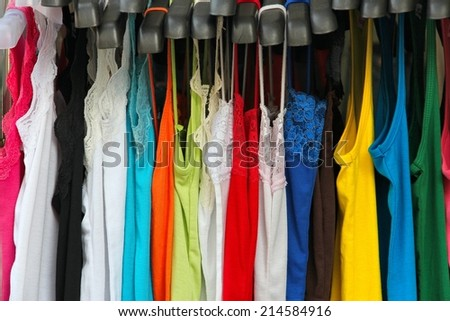 Fashion shopping in Bangkok - colorful blouses and dresses at a street market.