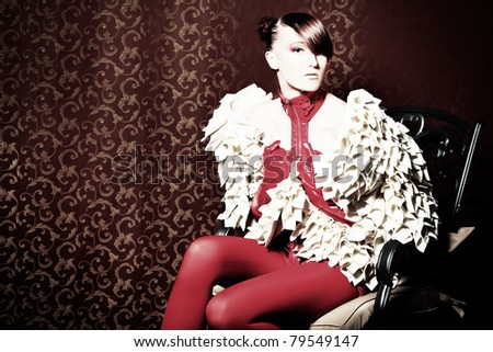Fashion shot of a beautiful model over vintage background. - stock photo