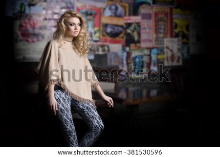 fashion shot of a beautiful sexy girl in fashionable clothes for the catalog with a bright evening make-up in the studio , demonstration of clothes a girl - stock photo