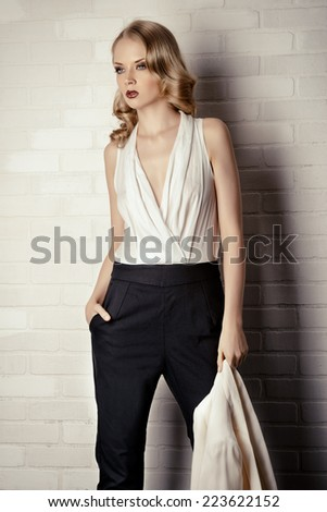 Fashion shot of a glamorous blonde woman. Successful business lady. - stock photo
