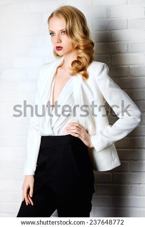 Fashion shot of a glamorous blonde woman. Successful business lady. - stock photo