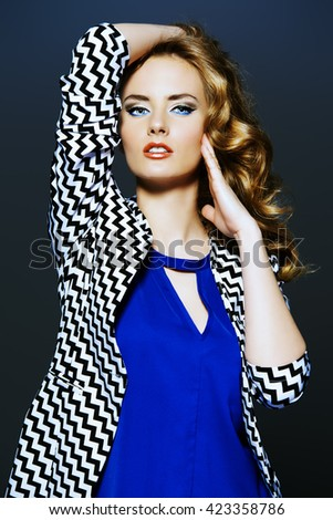 Fashion shot of a gorgeous female model with beautiful wavy hair. Bright make-up, cosmetics. - stock photo