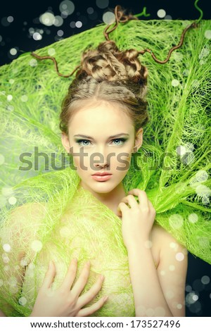 Fashion shot of a stunning female model with beautiful hairstyle. Spring beauty. - stock photo