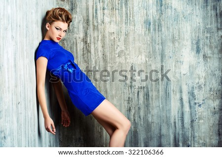 Fashion shot of a stunning female model with bright makeup. Beauty, fashion. - stock photo