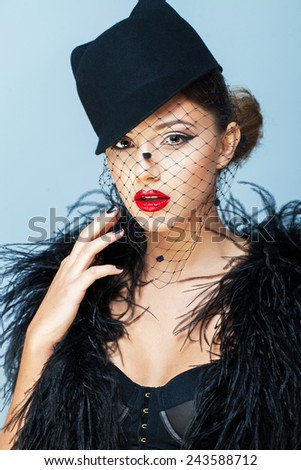 Fashion shot of a trendy young lady - stock photo