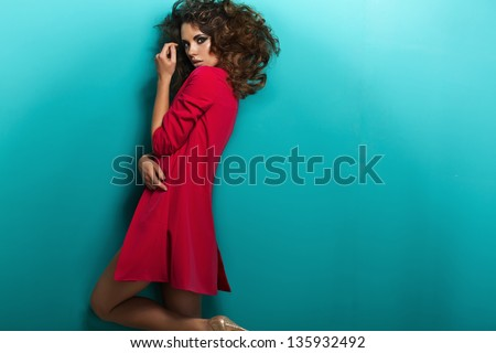 Fashion shot of a woman in pink coat - stock photo