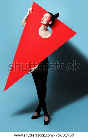 Fashion shot of an attractive model. Make-up. Shapes concept. - stock photo