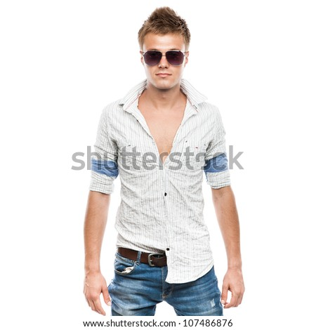 Fashion shot of an elegant young man in sunglasses, isolated on white background