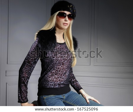 fashion shot of girl with sunglasses posing