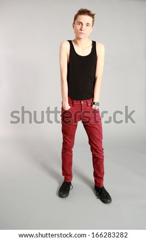 fashion shot of thin young male model in studio - stock photo