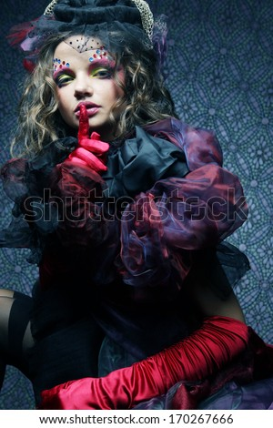 Fashion shot of woman in doll style. Creative make-up.Fantasy dress. - stock photo