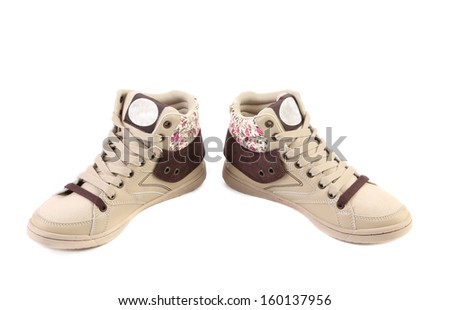 Fashion sneakers closeup. Isolated on a white background.