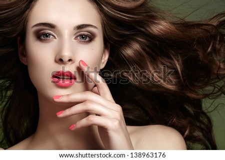 Fashion spring/summer look. Beautiful young woman with bright makeup, clean face, flying healthy long hair, pink manicure. - stock photo