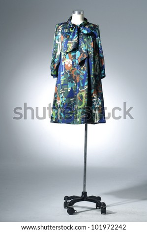 Fashion striped Shirt clothing hanging on hangers - stock photo