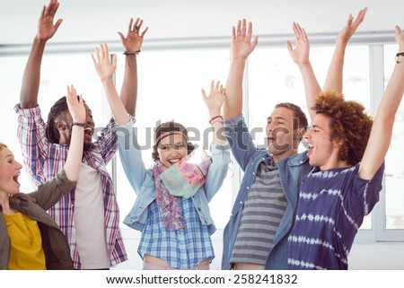 Fashion students cheering together at the college