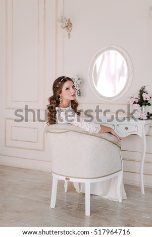 fashion studio photo of beautiful elegant bride with dark hair in luxurious wedding dress