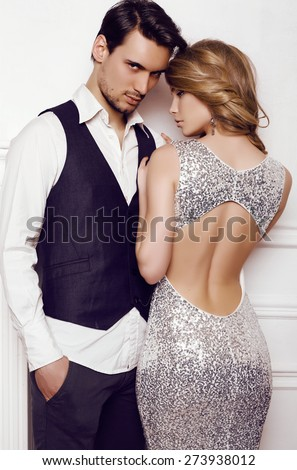 fashion studio photo of beautiful sensual couple in elegant clothes - stock photo