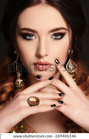 fashion studio photo of beautiful young woman with  dark hair and bright makeup,with bijou - stock photo