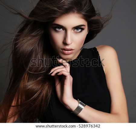 fashion studio  photo of gorgeous woman with dark  hair in elegant dress with accessories