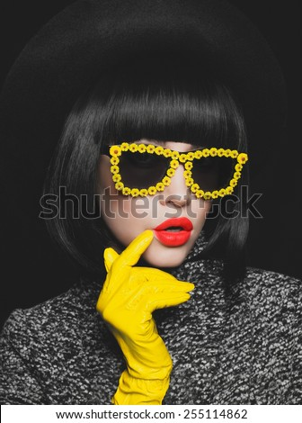 Fashion studio photo of stylish lady in gloves and sunglasses - stock photo
