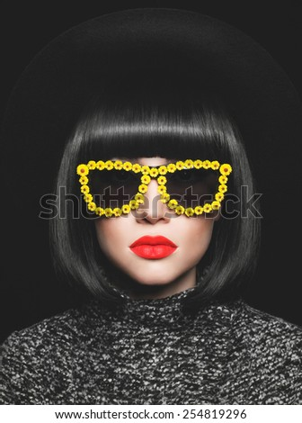 Fashion studio photo of stylish lady in hat and sunglasses - stock photo