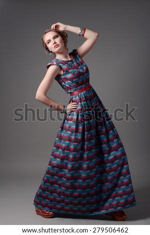 fashion studio portrait of beautiful girl in dress - stock photo