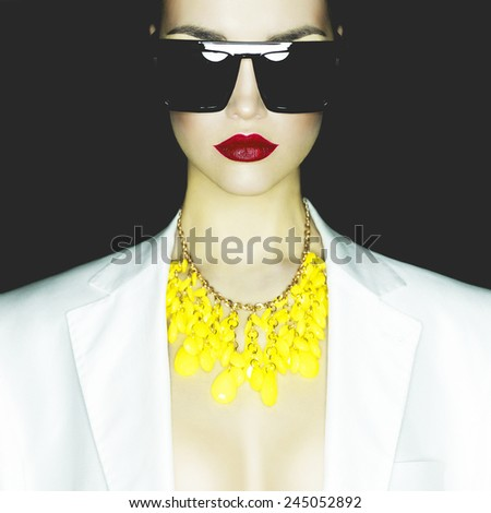 Fashion studio portrait of beautiful woman with sunglasses - stock photo