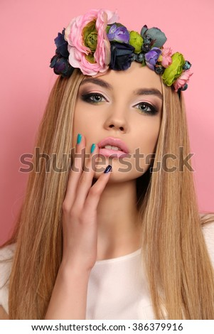 fashion studio portrait of beautiful young girl with long blond hair with elegant flower's headband - stock photo