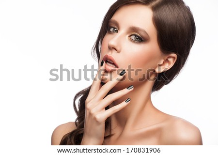 Fashion studio portrait of young beautiful woman with bright makeup and black manicure, isolated on white - stock photo