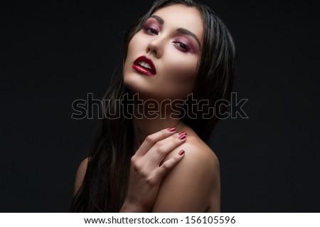 Fashion studio shot of beautiful woman with stylish makeup and manicure - stock photo