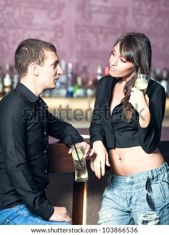 Fashion style photo of a couple in the bar - stock photo