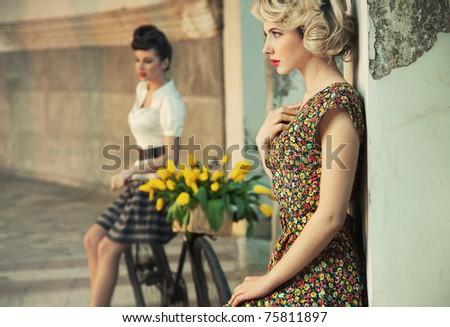 Fashion style photo of a gorgeous women wearing retro clothes - stock photo