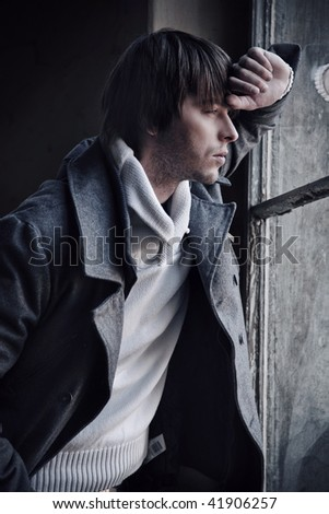 Fashion style photo of a handsome guy - stock photo