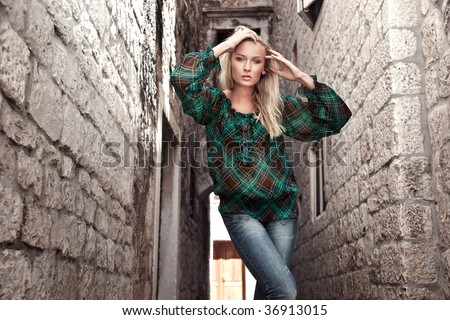 Fashion style photo of a young girl - stock photo